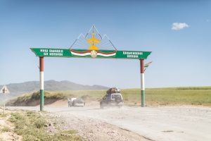 Cars crossing a sign in Tajikistan