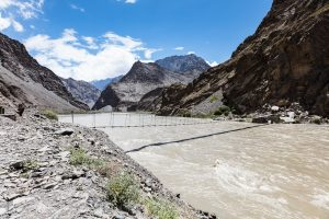 Little bridge over big river in Tajikistan