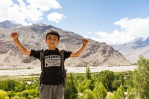 Young boy with mountains in the background